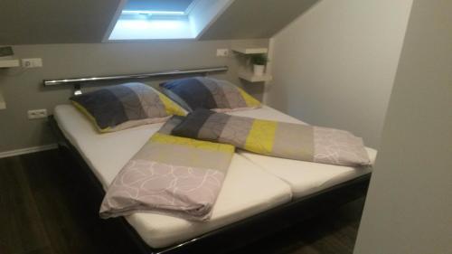 Ein Bett oder Betten in einem Zimmer der Unterkunft Ferienwohnung Wesertraum