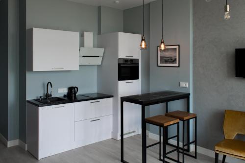 Кухня или мини-кухня в Raushen Elegance Apartments