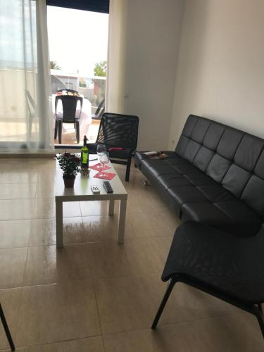A seating area at Apartamentos H3 Belman Playa