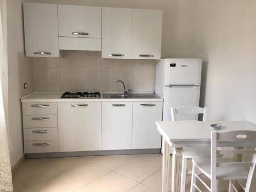 Cucina o angolo cottura di Appartamenti Le Buganville