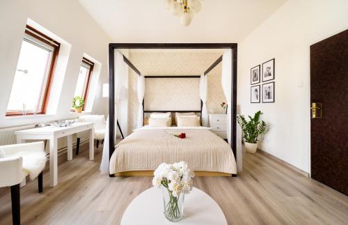 A bed or beds in a room at A/C + TERRACE Breakfast at Tiffany's