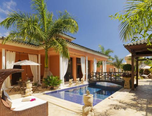 The swimming pool at or near Royal Garden Villas Boutique & Spa