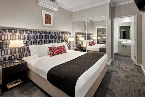 A bed or beds in a room at Quest Campbelltown