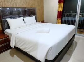 1 BR Cosmo Mansion W/ Direct Access To Thamrin City Mall By Travelio