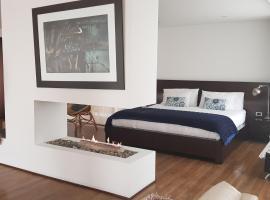 Suites Casa 95