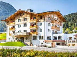 OFENTÜRL alpine living, Ferienwohnung in Flachau