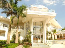 The Falls Hotel, hotel in Guarujá