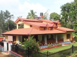 Whistling Woods Farm Stay, pet-friendly hotel in Kushālnagar