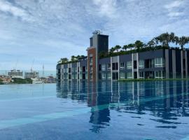The Metropolis*Infinity pool*Sunbathing*BTS Station Nearby*Pick up free*Beautiful Condo