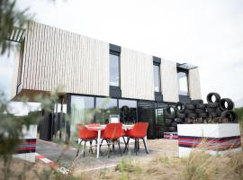 Modern, trendy F1 theme lodge, just 100 m. from the sea