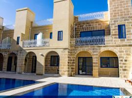 Fiftyfour West Boutique Living, B&B in Għarb