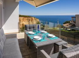 Villa Benagil with stunning views and roof terrace with private heated pool