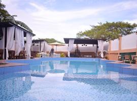 OYO 599 Palawan Village Hotel, отель в Пуэрто-Принсеса
