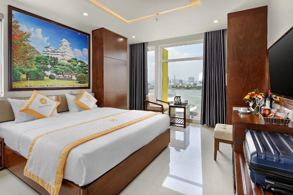 Hình của Phòng Deluxe Giường Đôi/2 Giường Đơn Nhìn Ra Sông #2