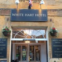The White Hart Hotel </h2 </a <div class=sr-card__item sr-card__item--badges <div class= sr-card__badge sr-card__badge--class u-margin:0  data-ga-track=click data-ga-category=SR Card Click data-ga-action=Hotel rating data-ga-label=book_window:  day(s)  <i class= bk-icon-wrapper bk-icon-stars star_track  title=3 stars  <svg aria-hidden=true class=bk-icon -sprite-ratings_stars_3 focusable=false height=10 width=32<use xlink:href=#icon-sprite-ratings_stars_3</use</svg                     <span class=invisible_spoken3 stars</span </i </div   <div class=sr-card__item__review-score style=padding: 8px 0  <div class=bui-review-score c-score bui-review-score--inline bui-review-score--smaller <div class=bui-review-score__badge aria-label=Scored 8.9  8.9 </div <div class=bui-review-score__content <div class=bui-review-score__title Fabulous </div </div </div   </div </div <div class=sr-card__item   data-ga-track=click data-ga-category=SR Card Click data-ga-action=Hotel location data-ga-label=book_window:  day(s)  <svg aria-hidden=true class=bk-icon -iconset-geo_pin sr_svg__card_icon focusable=false height=12 role=presentation width=12<use xlink:href=#icon-iconset-geo_pin</use</svg <div class= sr-card__item__content   Martock • <span 150 yards </span  from centre </div </div </div </div </div </li <li id=hotel_116851 data-is-in-favourites=0 data-hotel-id='116851' class=sr-card sr-card--arrow bui-card bui-u-bleed@small js-sr-card m_sr_info_icons card-halved card-halved--active   <div data-href=/hotel/gb/thehollieshotel.en-gb.html onclick=window.open(this.getAttribute('data-href')); target=_blank class=sr-card__row bui-card__content data-et-click= data-et-view=  <div class=sr-card__image js-sr_simple_card_hotel_image has-debolded-deal js-lazy-image sr-card__image--lazy data-src=https://q-cf.bstatic.com/xdata/images/hotel/square200/186280304.jpg?k=8110c6c2880dd30e3b07223eec862a459c1df4360cf78deccd1617b4a9241cee&o=&s=1,https://r-cf.bstatic.com/xdata/images/hotel/max1024x768/186280304.jpg?k=7465589c3848ab0f89843507a4b8a5508e424ac162ce802a3d66ace3e741d8d6&o=&s=1  <div class=sr-card__image-inner css-loading-hidden </div <noscript <div class=sr-card__image--nojs style=background-image: url('https://q-cf.bstatic.com/xdata/images/hotel/square200/186280304.jpg?k=8110c6c2880dd30e3b07223eec862a459c1df4360cf78deccd1617b4a9241cee&o=&s=1')</div </noscript </div <div class=sr-card__details data-et-click=customGoal:NAREFGCQABaOSJIaPdMYTQDZBaDMWPHDDWe:2   <div class=sr-card_details__inner <a href=/hotel/gb/thehollieshotel.en-gb.html onclick=event.stopPropagation(); target=_blank <h2 class=sr-card__name u-margin:0 u-padding:0 data-ga-track=click data-ga-category=SR Card Click data-ga-action=Hotel name data-ga-label=book_window:  day(s)  Hollies Hotel </h2 </a <div class=sr-card__item sr-card__item--badges <div class= sr-card__badge sr-card__badge--class u-margin:0  data-ga-track=click data-ga-category=SR Card Click data-ga-action=Hotel rating data-ga-label=book_window:  day(s)  <i class= bk-icon-wrapper bk-icon-stars star_track  title=3 stars  <svg aria-hidden=true class=bk-icon -sprite-ratings_stars_3 focusable=false height=10 width=32<use xlink:href=#icon-sprite-ratings_stars_3</use</svg                     <span class=invisible_spoken3 stars</span </i </div   <div class=sr-card__item__review-score style=padding: 8px 0  <div class=bui-review-score c-score bui-review-score--inline bui-review-score--smaller <div class=bui-review-score__badge aria-label=Scored 9.1  9.1 </div <div class=bui-review-score__content <div class=bui-review-score__title Superb </div </div </div   </div </div <div class=sr-card__item   data-ga-track=click data-ga-category=SR Card Click data-ga-action=Hotel location data-ga-label=book_window:  day(s)  <svg aria-hidden=true class=bk-icon -iconset-geo_pin sr_svg__card_icon focusable=false height=12 role=presentation width=12<use xlink:href=#icon-iconset-geo_pin</use</svg <div class= sr-card__item__content   Martock • <span 0.9 miles </span  from centre </div </div </div </div </div </li <li id=hotel_6178686 data-is-in-favourites=0 data-hotel-id='6178686' class=sr-card sr-card--arrow bui-card bui-u-bleed@small js-sr-card m_sr_info_icons card-halved card-halved--active   <div data-href=/hotel/gb/the-coach-house-martock.en-gb.html onclick=window.open(this.getAttribute('data-href')); target=_blank class=sr-card__row bui-card__content data-et-click= data-et-view=  <div class=sr-card__image js-sr_simple_card_hotel_image has-debolded-deal js-lazy-image sr-card__image--lazy data-src=https://r-cf.bstatic.com/xdata/images/hotel/square200/241726775.jpg?k=4040fa241e5591a6ab83832ac903d24365dad24e401f26d225c866a27e81fb63&o=&s=1,https://r-cf.bstatic.com/xdata/images/hotel/max1024x768/241726775.jpg?k=e70f6e35d35ed0266719649f07d44af8d19a7c0ef9253dd51ad632e9174b3227&o=&s=1  <div class=sr-card__image-inner css-loading-hidden </div <noscript <div class=sr-card__image--nojs style=background-image: url('https://r-cf.bstatic.com/xdata/images/hotel/square200/241726775.jpg?k=4040fa241e5591a6ab83832ac903d24365dad24e401f26d225c866a27e81fb63&o=&s=1')</div </noscript </div <div class=sr-card__details data-et-click=customGoal:NAREFGCQABaOSJIaPdMYTQDZBaDMWPHDDWe:1   <div class=sr-card_details__inner <a href=/hotel/gb/the-coach-house-martock.en-gb.html onclick=event.stopPropagation(); target=_blank <h2 class=sr-card__name u-margin:0 u-padding:0 data-ga-track=click data-ga-category=SR Card Click data-ga-action=Hotel name data-ga-label=book_window:  day(s)  The Coach House </h2 </a <div data-et-view=NAREFGCQABaOSJIaPdMYTQDZBaDMWPHDDWe:4</div <div class=sr-card__item sr-card__item--badges <div class=sr-card__item__review-score style=padding: 8px 0    </div </div <div class=sr-card__item   data-ga-track=click data-ga-category=SR Card Click data-ga-action=Hotel location data-ga-label=book_window:  day(s)  <svg aria-hidden=true class=bk-icon -iconset-geo_pin sr_svg__card_icon focusable=false height=12 role=presentation width=12<use xlink:href=#icon-iconset-geo_pin</use</svg <div class= sr-card__item__content   Martock • <span 50 yards </span  from centre </div </div </div </div </div </li <div data-et-view=dLYHMRFeRLTbECERe:1</div <div data-et-view=dLYHMRFeRLTbECEQeFdLYSeHT:1</div <li id=hotel_5465782 data-is-in-favourites=0 data-hotel-id='5465782' class=sr-card sr-card--arrow bui-card bui-u-bleed@small js-sr-card m_sr_info_icons card-halved card-halved--active   <div data-href=/hotel/gb/french-house.en-gb.html onclick=window.open(this.getAttribute('data-href')); target=_blank class=sr-card__row bui-card__content data-et-click= data-et-view=  <div class=sr-card__image js-sr_simple_card_hotel_image has-debolded-deal js-lazy-image sr-card__image--lazy data-src=https://r-cf.bstatic.com/xdata/images/hotel/square200/213714663.jpg?k=affa613778cf972d1fb2109059920a3ef62205aec54f935a84e34ceea9ac896f&o=&s=1,https://r-cf.bstatic.com/xdata/images/hotel/max1024x768/213714663.jpg?k=8b9bb776e1772c34f7d9d0507bc320e40a71e4a7d85b31a0c3cbf444b3d08fb1&o=&s=1  <div class=sr-card__image-inner css-loading-hidden </div <noscript <div class=sr-card__image--nojs style=background-image: url('https://r-cf.bstatic.com/xdata/images/hotel/square200/213714663.jpg?k=affa613778cf972d1fb2109059920a3ef62205aec54f935a84e34ceea9ac896f&o=&s=1')</div </noscript </div <div class=sr-card__details data-et-click=customGoal:NAREFGCQABaOSJIaPdMYTQDZBaDMWPHDDWe:1   <div class=sr-card_details__inner <a href=/hotel/gb/french-house.en-gb.html onclick=event.stopPropagation(); target=_blank <h2 class=sr-card__name u-margin:0 u-padding:0 data-ga-track=click data-ga-category=SR Card Click data-ga-action=Hotel name data-ga-label=book_window:  day(s)  French house </h2 </a <div data-et-view=NAREFGCQABaOSJIaPdMYTQDZBaDMWPHDDWe:4</div <div class=sr-card__item sr-card__item--badges <div class=sr-card__item__review-score style=padding: 8px 0    </div </div <div class=sr-card__item   data-ga-track=click data-ga-category=SR Card Click data-ga-action=Hotel location data-ga-label=book_window:  day(s)  <svg aria-hidden=true class=bk-icon -iconset-geo_pin sr_svg__card_icon focusable=false height=12 role=presentation width=12<use xlink:href=#icon-iconset-geo_pin</use</svg <div class= sr-card__item__content   Martock • <span 750 yards </span  from centre </div </div </div </div </div </li <li id=hotel_3009478 data-is-in-favourites=0 data-hotel-id='3009478' class=sr-card sr-card--arrow bui-card bui-u-bleed@small js-sr-card m_sr_info_icons card-halved card-halved--active   <div data-href=/hotel/gb/bower-coach-house.en-gb.html onclick=window.open(this.getAttribute('data-href')); target=_blank class=sr-card__row bui-card__content data-et-click= data-et-view=  <div class=sr-card__image js-sr_simple_card_hotel_image has-debolded-deal js-lazy-image sr-card__image--lazy data-src=https://r-cf.bstatic.com/xdata/images/hotel/square200/125491329.jpg?k=491d8d60a1957d793c71abd6e93f5e935f29d2c25fd81cacb4de82c309a92586&o=&s=1,https://q-cf.bstatic.com/xdata/images/hotel/max1024x768/125491329.jpg?k=a7ec4b0e5c90a678cd61fef6f48010a7acfe440a85341c89613a32d790739fd3&o=&s=1  <div class=sr-card__image-inner css-loading-hidden </div <noscript <div class=sr-card__image--nojs style=background-image: url('https://r-cf.bstatic.com/xdata/images/hotel/square200/125491329.jpg?k=491d8d60a1957d793c71abd6e93f5e935f29d2c25fd81cacb4de82c309a92586&o=&s=1')</div </noscript </div <div class=sr-card__details data-et-click=customGoal:NAREFGCQABaOSJIaPdMYTQDZBaDMWPHDDWe:2   <div class=sr-card_details__inner <a href=/hotel/gb/bower-coach-house.en-gb.html onclick=event.stopPropagation(); target=_blank <h2 class=sr-card__name u-margin:0 u-padding:0 data-ga-track=click data-ga-category=SR Card Click data-ga-action=Hotel name data-ga-label=book_window:  day(s)  Bower Coach House </h2 </a <div class=sr-card__item sr-card__item--badges <div class= sr-card__badge sr-card__badge--class u-margin:0  data-ga-track=click data-ga-category=SR Card Click data-ga-action=Hotel rating data-ga-label=book_window:  day(s)  <i class= bk-icon-wrapper bk-icon-stars star_track  title=4 stars  <svg aria-hidden=true class=bk-icon -sprite-ratings_stars_4 focusable=false height=10 width=43<use xlink:href=#icon-sprite-ratings_stars_4</use</svg                     <span class=invisible_spoken4 stars</span </i </div   <div class=sr-card__item__review-score style=padding: 8px 0    </div </div <div class=sr-card__item   data-ga-track=click data-ga-category=SR Card Click data-ga-action=Hotel location data-ga-label=book_window:  day(s)  <svg aria-hidden=true class=bk-icon -iconset-geo_pin sr_svg__card_icon focusable=false height=12 role=presentation width=12<use xlink:href=#icon-iconset-geo_pin</use</svg <div class= sr-card__item__content   Martock • <span 1 miles </span  from centre </div </div </div </div </div </li <li data-et-view=NAFLeNIJWPHDDHUSeZRBUfFAeFaMEAbbMVaXT:1</li <li id=hotel_4734519 data-is-in-favourites=0 data-hotel-id='4734519' class=sr-card sr-card--arrow bui-card bui-u-bleed@small js-sr-card m_sr_info_icons card-halved card-halved--active   <div data-href=/hotel/gb/boleyn-house-the-annexe.en-gb.html onclick=window.open(this.getAttribute('data-href')); target=_blank class=sr-card__row bui-card__content data-et-click= data-et-view=  <div class=sr-card__image js-sr_simple_card_hotel_image has-debolded-deal js-lazy-image sr-card__image--lazy data-src=https://q-cf.bstatic.com/xdata/images/hotel/square200/241718425.jpg?k=720e2b9b86536ad2dfadc63d938467e745b98bd62c4e7c92b249eef7630d69b8&o=&s=1,https://q-cf.bstatic.com/xdata/images/hotel/max1024x768/241718425.jpg?k=c1481052eef7851dac310f4b4549e3f902d50400e890f9dd32a615371e7005ba&o=&s=1  <div class=sr-card__image-inner css-loading-hidden </div <noscript <div class=sr-card__image--nojs style=background-image: url('https://q-cf.bstatic.com/xdata/images/hotel/square200/241718425.jpg?k=720e2b9b86536ad2dfadc63d938467e745b98bd62c4e7c92b249eef7630d69b8&o=&s=1')</div </noscript </div <div class=sr-card__details data-et-click=customGoal:NAREFGCQABaOSJIaPdMYTQDZBaDMWPHDDWe:1   <div class=sr-card_details__inner <a href=/hotel/gb/boleyn-house-the-annexe.en-gb.html onclick=event.stopPropagation(); target=_blank <h2 class=sr-card__name u-margin:0 u-padding:0 data-ga-track=click data-ga-category=SR Card Click data-ga-action=Hotel name data-ga-label=book_window:  day(s)  Boleyn House, The Annexe </h2 </a <div data-et-view=NAREFGCQABaOSJIaPdMYTQDZBaDMWPHDDWe:4</div <div class=sr-card__item sr-card__item--badges <div class= sr-card__badge sr-card__badge--class u-margin:0  data-ga-track=click data-ga-category=SR Card Click data-ga-action=Hotel rating data-ga-label=book_window:  day(s)  <span class=bh-quality-bars bh-quality-bars--small   <svg class=bk-icon -iconset-square_rating fill=#FEBB02 height=12 width=12<use xlink:href=#icon-iconset-square_rating</use</svg<svg class=bk-icon -iconset-square_rating fill=#FEBB02 height=12 width=12<use xlink:href=#icon-iconset-square_rating</use</svg<svg class=bk-icon -iconset-square_rating fill=#FEBB02 height=12 width=12<use xlink:href=#icon-iconset-square_rating</use</svg </span </div   <div class=sr-card__item__review-score style=padding: 8px 0  <div class=bui-review-score c-score bui-review-score--inline bui-review-score--smaller <div class=bui-review-score__badge aria-label=Scored 9.5  9.5 </div <div class=bui-review-score__content <div class=bui-review-score__title Exceptional </div </div </div   </div </div <div class=sr-card__item   data-ga-track=click data-ga-category=SR Card Click data-ga-action=Hotel location data-ga-label=book_window:  day(s)  <svg aria-hidden=true class=bk-icon -iconset-geo_pin sr_svg__card_icon focusable=false height=12 role=presentation width=12<use xlink:href=#icon-iconset-geo_pin</use</svg <div class= sr-card__item__content   Martock • <span 1.3 miles </span  from centre </div </div </div </div </div </li <li class=bui-card bui-u-bleed@small bh-quality-sr-explanation-card <div class=bh-quality-sr-explanation  <span class=bh-quality-bars bh-quality-bars--small   <svg class=bk-icon -iconset-square_rating fill=#FEBB02 height=12 width=12<use xlink:href=#icon-iconset-square_rating</use</svg<svg class=bk-icon -iconset-square_rating fill=#FEBB02 height=12 width=12<use xlink:href=#icon-iconset-square_rating</use</svg<svg class=bk-icon -iconset-square_rating fill=#FEBB02 height=12 width=12<use xlink:href=#icon-iconset-square_rating</use</svg </span A new Booking.com quality rating for home and apartment-like properties. <button type=button class=bui-link bui-link--primary aria-label=Open Modal data-modal-id=bh_quality_learn_more data-bui-component=Modal data-et-click=customGoal:NAFLeNIJWPHDDHUSeZRBUfFAeFaMEAbbMVaXT:1   <span class=bui-button__textLearn more</span </button </div <template id=bh_quality_learn_more <header class=bui-modal__header <h1 class=bui-modal__title id=myModal-title data-bui-ref=modal-title Quality ratings </h1 </header <div class=bui-modal__body bui-modal__body--primary bh-quality-modal <h3 class=bh-quality-modal__heading <span class=bh-quality-bars bh-quality-bars--small   <svg class=bk-icon -iconset-square_rating fill=#FEBB02 height=12 width=12<use xlink:href=#icon-iconset-square_rating</use</svg<svg class=bk-icon -iconset-square_rating fill=#FEBB02 height=12 width=12<use xlink:href=#icon-iconset-square_rating</use</svg<svg class=bk-icon -iconset-square_rating fill=#FEBB02 height=12 width=12<use xlink:href=#icon-iconset-square_rating</use</svg<svg class=bk-icon -iconset-square_rating fill=#FEBB02 height=12 width=12<use xlink:href=#icon-iconset-square_rating</use</svg<svg class=bk-icon -iconset-square_rating fill=#FEBB02 height=12 width=12<use xlink:href=#icon-iconset-square_rating</use</svg </span