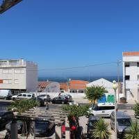 Apartamento com garagem e vista de mar