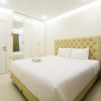1BR The Wave Apartment near Kota Kasablanka By Travelio