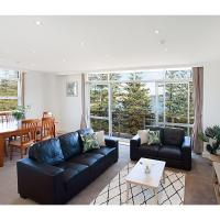 View Of Manly Pines And Waves From Large Apartment