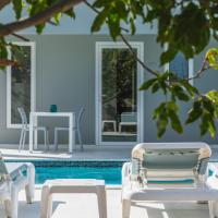 Hideout Suites - steps from Eagle Beach