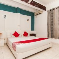 OYO 115 Qi Mag Beach Apartments