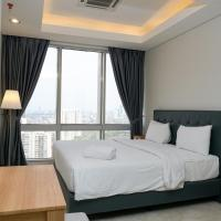 Modern and Comfortable 2BR at The Masterpiece Condominium Epicentrum Apartment By Travelio