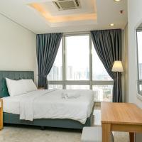 Cozy 2BR @ The Masterpiece Condominium Epicentrum Apartment By Travelio