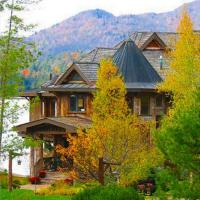 Cozy Log Castle - Upper St Regis Lake Waterfront with Boat Dock, hotel in Saranac Lake