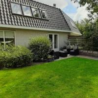 Holiday Home de witte raaf with garden and hottub