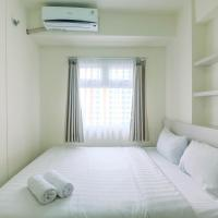 Chic and Cozy 2BR Apartment at Green Pramuka City By Travelio