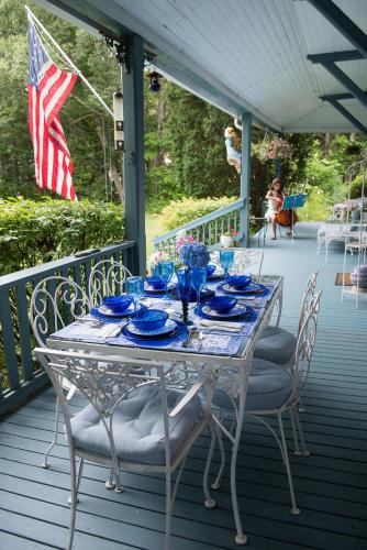Our breakfast setting on our lovely wrap-around porch with sea view.