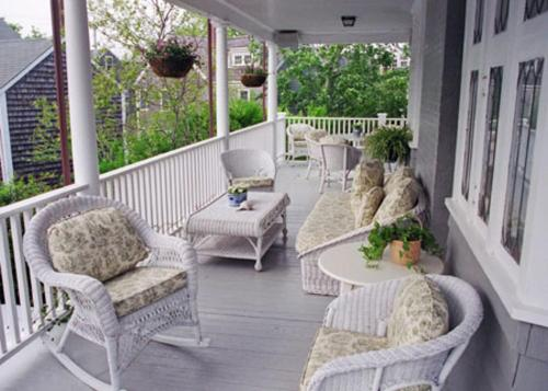 Our side porch where guests sip coffee, wine, read, rest.