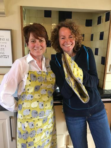 Sara with Kate Humble cooking breakfast